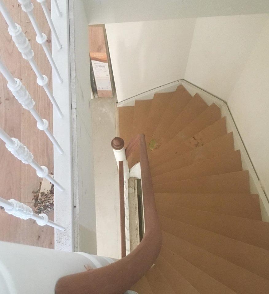Hardhouten trap in een monumentale pand