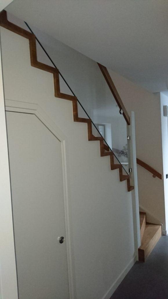 Eiken trap met glaswerk